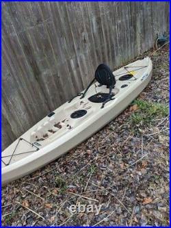 Fishing kayak used with original paddle, and fishing rod holder